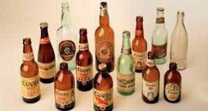 Assortment of antique Coors beer bottles.