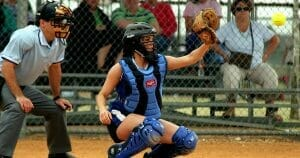Ball streaking toward catcher's mitt.